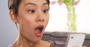 Chinese woman shocked after reading message Royalty Free Stock Photo