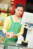 Chinese woman shop worker Royalty Free Stock Photo