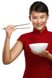 Chinese woman showing asian food using chopstick Royalty Free Stock Photos