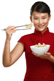 Chinese woman showing asian food using chopstick Stock Image