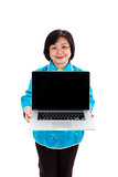 Chinese Woman showing a laptop. In front of her, smiling, wearing glasses, on white background royalty free stock photos