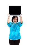Chinese Woman showing a laptop. Above her head, smiling, wearing glasses, on white background stock image