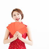 Chinese woman  showing Red envelopes and thinking Stock Photo