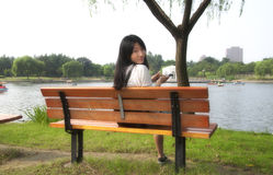 Chinese woman sitting bench royalty free stock photos