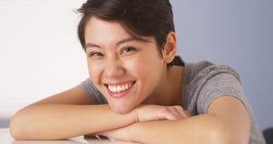 Chinese woman smiling at camera Royalty Free Stock Photos