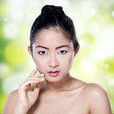 Chinese woman with smooth skin Stock Photos