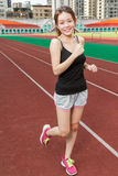 Chinese woman on sports track jogging Stock Photos