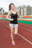 Chinese woman on sports track jogging Royalty Free Stock Photo