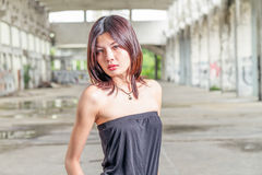 Chinese woman standing in abandoned building Royalty Free Stock Photography