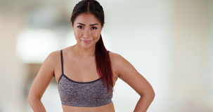 Chinese woman standing at the gym royalty free stock photography