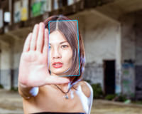 Chinese woman taking selfie with virtual interface Stock Photo
