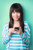 Chinese Woman texting on her mobile phone. Royalty Free Stock Image