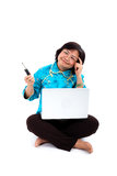 Chinese Woman thinking how to fix laptop Royalty Free Stock Photo