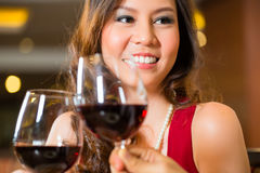Chinese woman toasting Stock Photography