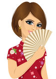 Chinese woman in traditional Cheongsam dress holding a fan Stock Photography