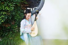 Chinese woman in traditional Hanfu dress,play traditional instrument of pipa Royalty Free Stock Image