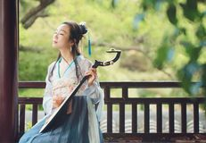 Chinese woman in traditional Hanfu dress,play traditional instrument of pipa Stock Image