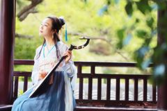 Chinese woman in traditional Hanfu dress,play traditional instrument of pipa Stock Images