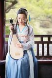 Chinese woman in traditional Hanfu dress,play traditional instrument of pipa Stock Photo