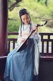 Chinese woman in traditional Hanfu dress,play traditional instrument of pipa Royalty Free Stock Images
