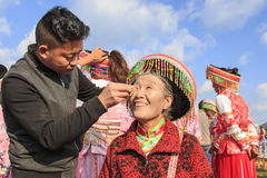 Chinese woman in traditional Miao attire during the Heqing Qifeng Pear Flower festival Royalty Free Stock Photography