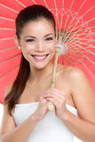 Chinese woman with traditional paper umbrella Stock Images