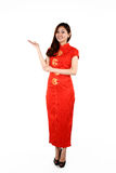 Chinese woman in traditional red Cheongsam presenting Royalty Free Stock Photos