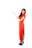 Chinese woman in traditional red Cheongsam presenting Royalty Free Stock Image