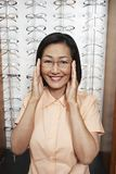 Chinese Woman Trying Out Glasses At Shop Stock Image