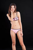 Chinese woman in underwear on black background Stock Photos