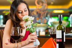 Chinese woman waiting in restaurant for date royalty free stock photos