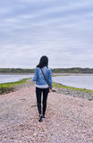 Chinese woman walking on a sand bar Royalty Free Stock Photos