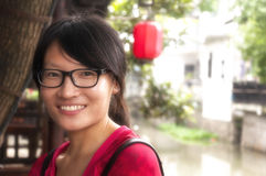 Chinese woman wearing glasses smiling Royalty Free Stock Image