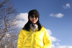 Chinese woman in winter in Stockbridge Massachusetts. A chinese woman wearing a winter coat and hat looking down at the camera on a cold winter day in New royalty free stock photo