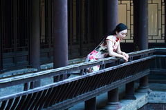 A Chinese woman wears traditional dress in the water park of Shanghai Stock Image