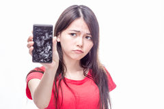 Chinese woman with cracked cell phone royalty free stock photography