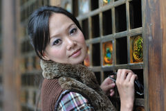Chinese women. A pretty women by chinese classical architecture Royalty Free Stock Photography