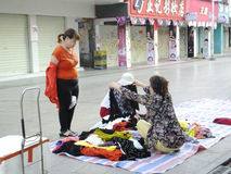 Chinese women buy clothes on the street. Morning, Xixiang Shenzhen commercial street, middle-aged and elderly women in the purchase of clothing Royalty Free Stock Photos