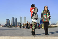 Chinese women on Dalian, Xinghai Square. DALIAN-NOV. 11, 2012. Women on Dalian Xinghai Square on Nov. 9, 2012. The city square is very popular among citizens and Stock Photography