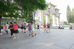 Chinese women dancing in front of a park in the morning stock photo