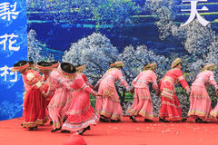 Chinese women dressed with traditional clothing dancing and singing during the Heqing Qifeng Pear Flower festival Stock Images