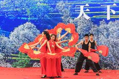 Chinese women dressed with traditional clothing dancing and singing during the Heqing Qifeng Pear Flower festival Royalty Free Stock Photography