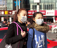 Chinese women with face mask Stock Images