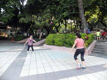 Chinese women kicking shuttlecock, exercise in the morning. Stock Photography