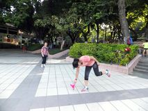Chinese women kicking shuttlecock, exercise in the morning. Stock Photos