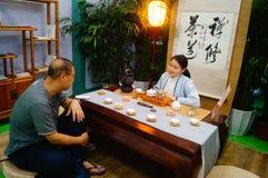 Chinese women perform in Zen tea Stock Photo