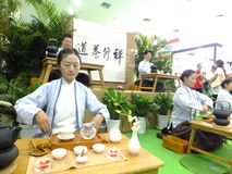 Chinese women performing tea art Royalty Free Stock Images
