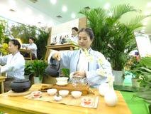 Chinese women performing tea art Royalty Free Stock Photos