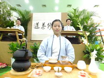Chinese women performing tea art Royalty Free Stock Photography