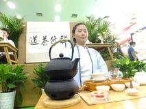 Chinese women performing tea art Royalty Free Stock Photo